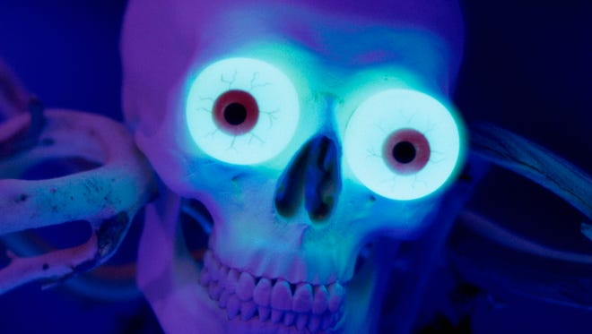 Close-up of glowing eyes in a human skull
