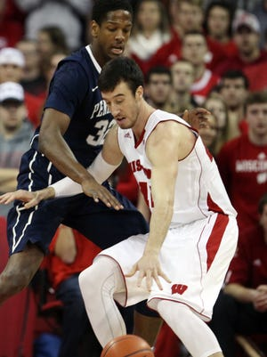 Wisconsin Badgers forward Frank Kaminsky (44) attempts to control the ball as Penn State Nittany Lions center Jordan Dickerson (32) defends during the first half at the Kohl Center.