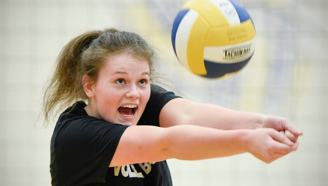 Kimball's Emma Kuechle bumps the ball up for a teammate during practice Tuesday, Nov. 8, at the Kimball High School. The Kimball volleyball is getting for their appearance at the state tournament.