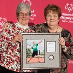 Betty Lunn was happy that members of her family were with her when she received her award at the New Jersey Special Olympics 2015 Awards Dinner in Princeton on Friday, November 21, 2015.Pictured (from left to right) are: Betty's cousin, 86, who shares the same birthday with her; Betty Lunn; Betty's son, Jason; Betty's niece Lori and her husband, Greg.