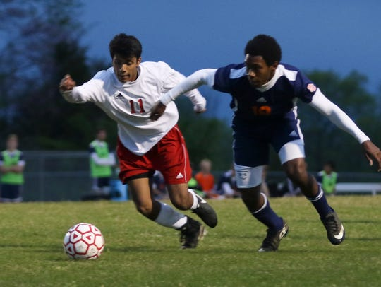 Rossview's Sager Patel (11) and Dickson County's Darius