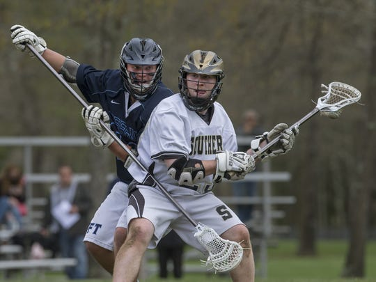 Southern's Will Johnson works his way in toward goal as he's covered by Freehold Township's Keenan Murphy during an SCT game on May 10, 2016.
