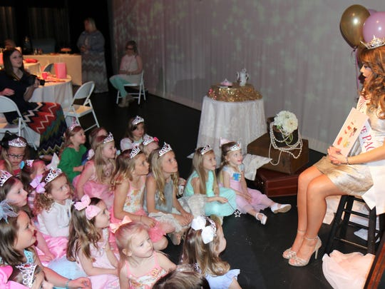 Lauren Dixon, Miss Dixie PAC 2018, held story time with the young ladies attending the Princess Tea Party at the Dixie Carter Performing Arts and Academic Enrichment Center in Huntingdon on Saturday, April 21, 2018.
