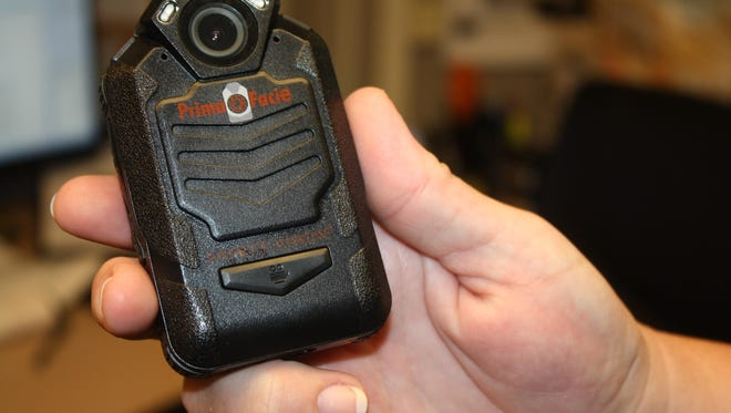 Alexandria Police Department Sgt. Natalie Selby holds a body camera.