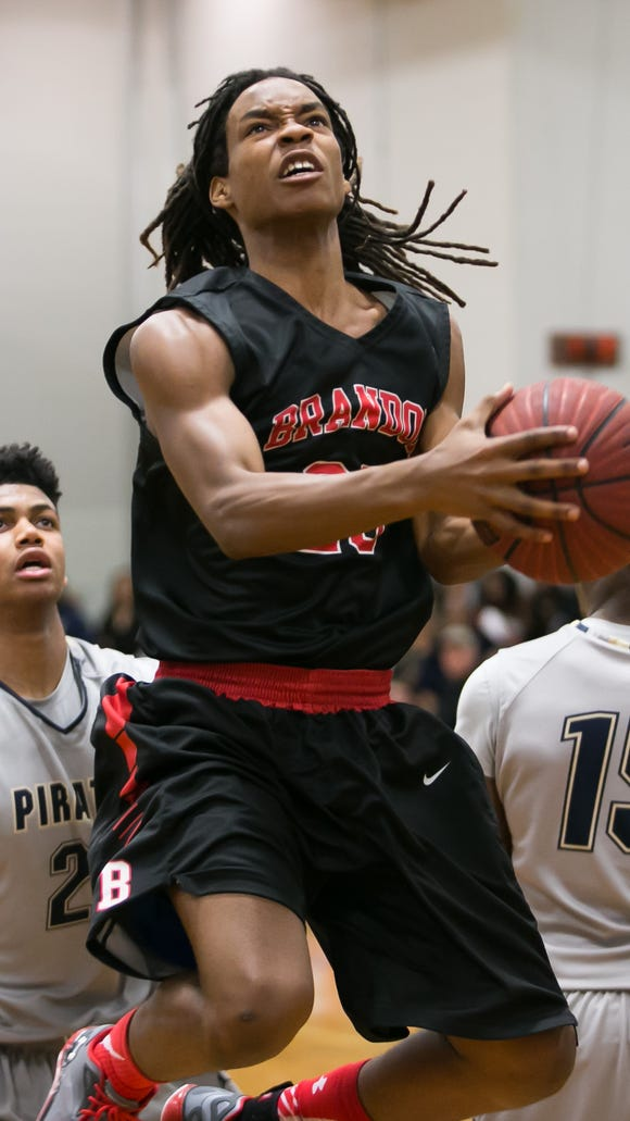 Brandon's Malik Morris (20) drives to the basket against Pearl Tuesday night at Pearl. (Bob Smith/Special to the Clarion Ledger)