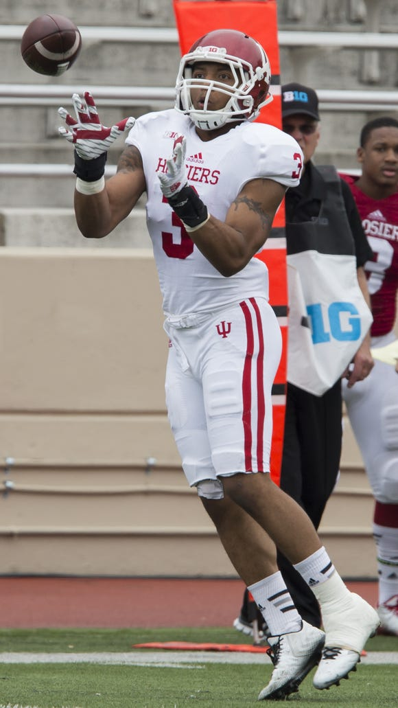 Indiana wide receiver Dominique Booth pulls in a catch during the Cream and Crimson Spring Game on Saturday, April 18, 2015, at Memorial Stadium in Bloomington. (James Brosher / For The Star)