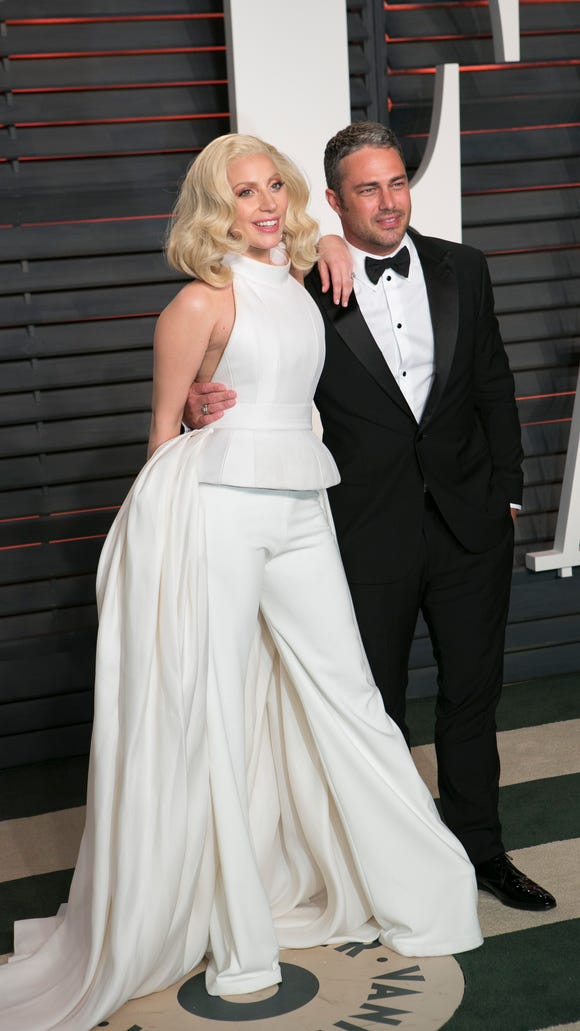 Her second white jumpsuit of the night.