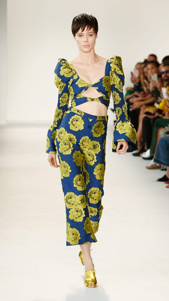 Model Coco Rocha led off Siriano's show with this blue-and-green