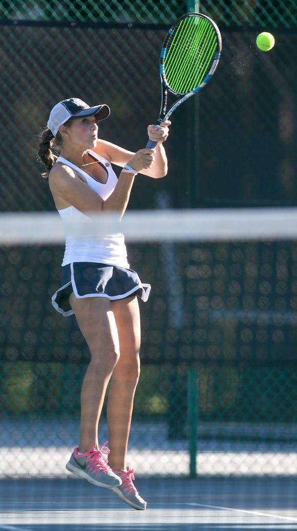 Asheville School's Rachel Kuehn returns a ball during