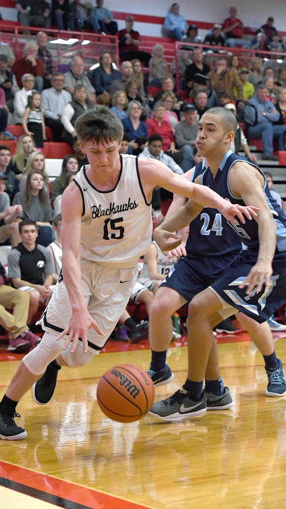 North Buncombe and Enka faced off in the semifinal round of the WMAC tournament at Erwin High School on Feb. 14. The Blackhawks defeated the Jets 64-51 to advance to the next round.