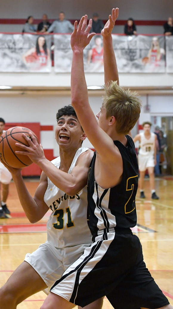 Reynolds'  Jeremiah Dorsey looks to go up for a shot against Tuscola's Jarred Swanger during the semi-final round of the WMAC tournament at Erwin High School on Wednesday, Feb. 14, 2018.