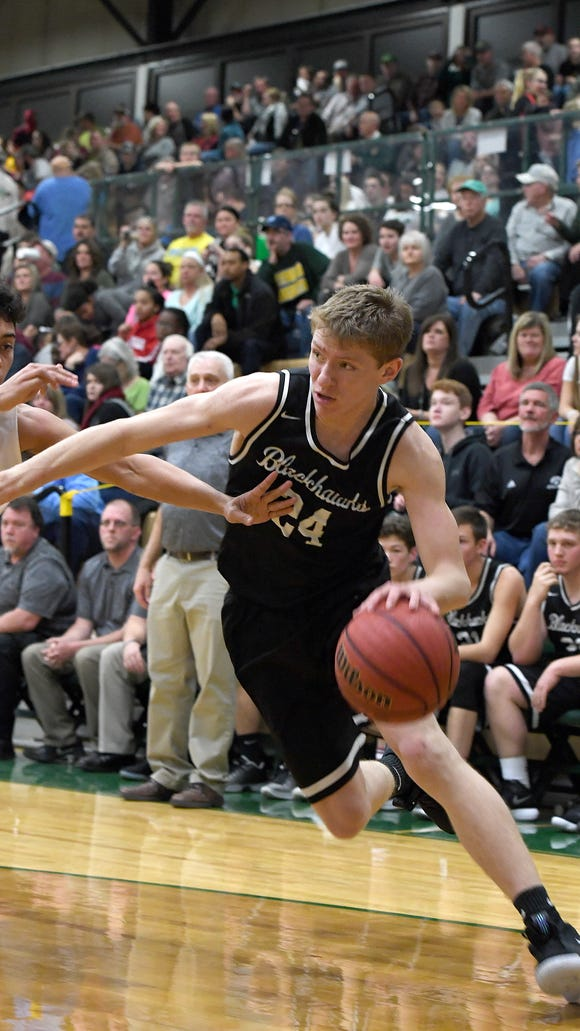 North Buncombe's Ren Dyer pushes past Reynolds' Trey Golden toward the basket during their game at Reynolds High School on Friday, Feb. 2, 2018. The Rockets defeated the Blackhawks 87-63.