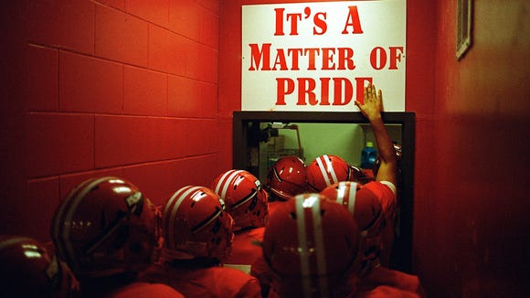 Following pre-game warmups and a rousing speech by coach Rodelin Anthony, the Immokalee High School football team exits their field house and hits the turf on Friday, Nov. 10, 2017.
