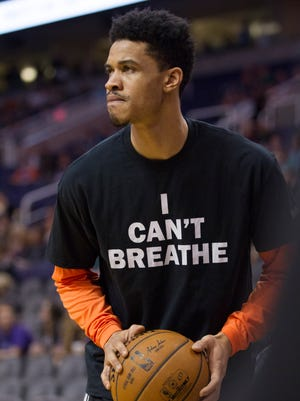 """Suns' Gerald Green wears an """"I CAN'T BREATHE"""" shirt in unison with the rest of the Suns' players showing support for Eric Garner at US Airways Center in Phoenix, AZ on Dec. 15, 2014."""