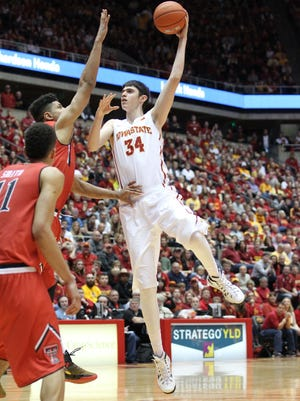 Feb 7, 2015; Ames, IA, USA; Iowa State Cyclones forward/center Georgios Tsalmpouris (34) scores on a jump hook from the paint against the Texas Tech Red Raiders at James H. Hilton Coliseum. Iowa State beat Texas Tech 75-38.  Mandatory Credit: Reese Strickland-USA TODAY Sports