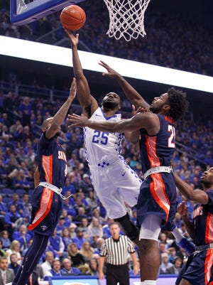 Nov 25, 2016; Lexington, KY, USA; Kentucky Wildcats guard Dominique Hawkins (25) shoots the ball against Tennessee-Martin Skyhawks guard Kahari Beaufort (22) in the first half at Rupp Arena.