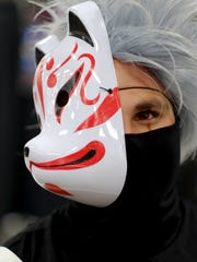 "Zen Yousafzai, dressed as Kakashi from the anime and manga series ""Naruto,"" is pictured during the 2016 Marble City Comic Con at the Knoxville Expo Center on Saturday, April 23, 2016."
