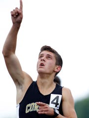 Corunna's Noah Jacobs celebrates after winning the 1600-meter run during the Division 2 MHSAA track finals, Saturday, June 3, 2017, in Zeeland, Mich.