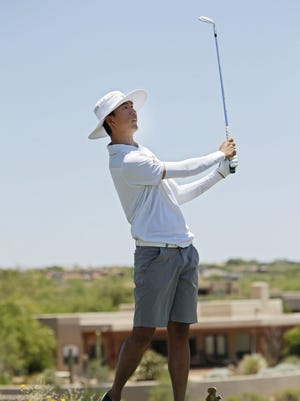 Jino Sohn of ASU shoots down the fairway on hole 10 during the final round Saturday. Amateur golfers from across the country competed in the Southwestern Amateur held at The Desert Mountain Club in Scottsdale this week. Arizona State's Jino Sohn took home first place Saturday after shooting 66 on the day.