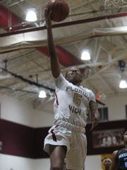 Florida High's Tonie Morgan hits a layup during a Region 1-5A quarterfinal win over North Bay Haven.