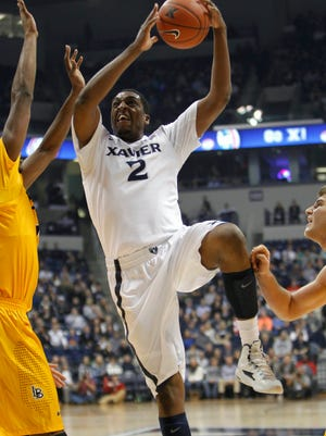 Xavier Musketeers forward James Farr (2) shoots during the first half against the Long Beach State 49ers at Cintas Center.
