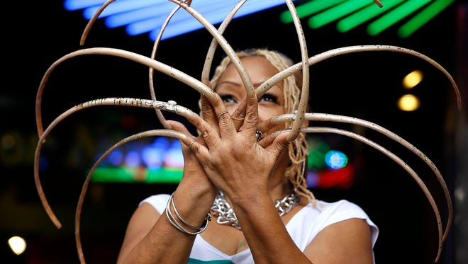 "Ayanna Williams displays her 23-inch nails at a book launch in London. Williams is featured in a book entitled ""Ripley's Believe it or Not! 2015 Annual, Reality Shock."""