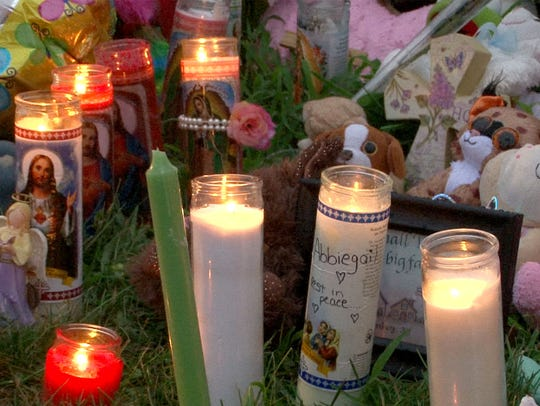 Candles, stuffed animals and balloons filled a memorial