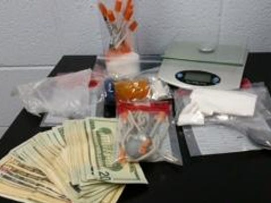 More than 11 grams of suspected heroin, cash and other