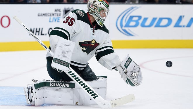 Minnesota Wild goalie Darcy Kemper (35) makes a save during the third period against the Los Angeles Kings at Staples Center. The Los Angeles Kings won in overtime 2-1.
