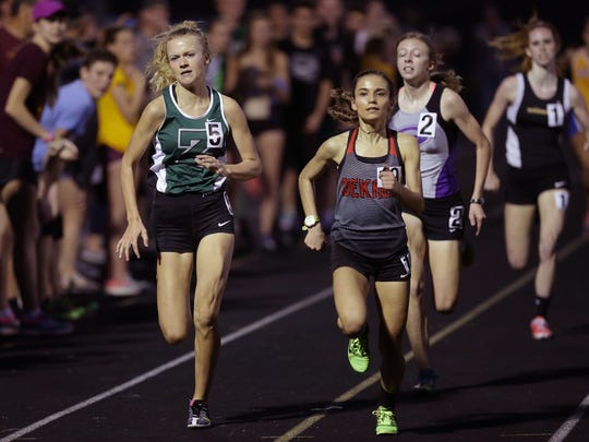 Zionsville's Sophia Rigg (5), left, won the Flashes Showcase mile April 14.