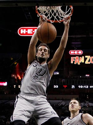 Marco Belinelli dunks home two of his 12 points for the Spurs.