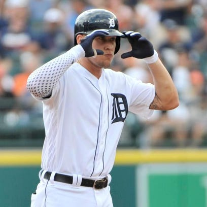 Tigers rookie JaCoby Jones signals to the dugout from