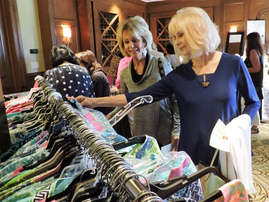 Judy Tenzyk and Susan Carnasiotis shop at one of the boutique shops at the Mary's Shelter Luncheon on Jan. 16.