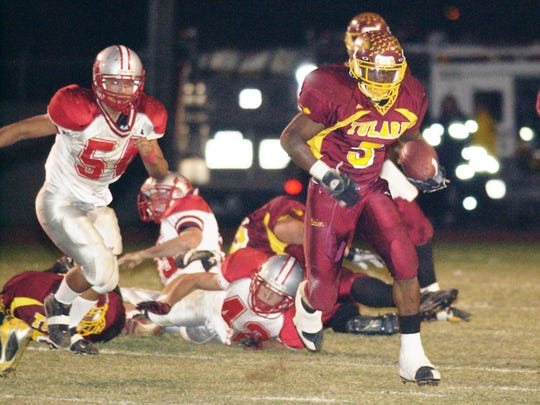 Tulare Union's Jontell Reedom, center, runs for yardage against North High in the second quarter. Tulare Union vs North High Stars at Bob Mathias Stadium in Tulare.