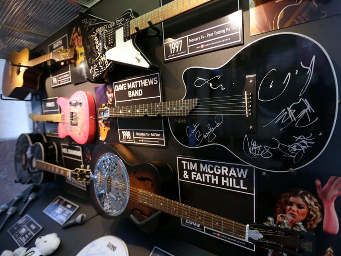 Some of the guitars signed by artists who performed