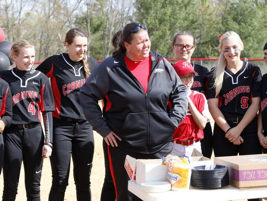 Corning coach Stacy Johnson, front, is honored for