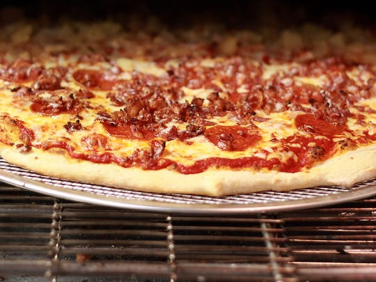 Prince Street Pizza and Pub owners Spencer Wakefield and Brad Singleton plan to open Portland Pizza and Pub by early spring.