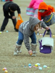 A young girl gathers eggs at the Portland Easter Egg Hunt on Sun. March 25, 2018.
