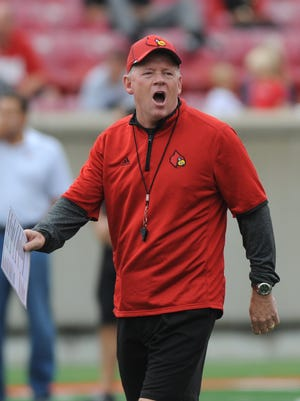 Louisville head coach Bobby Petrino yells instructions during a scrimmage game on Saturday at Papa John's Cardinal Stadium. (By David Lee Hartlage, Special to the C-J) Aug. 16, 2014.