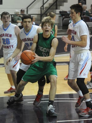 May's Wyatt Mote looks for room to maneuver beneath the basket against the Borden County defense. Borden County beat the Tigers 49-36 in the Region II-1A semifinals Friday, March 3 2017 at Moody Coliseum.