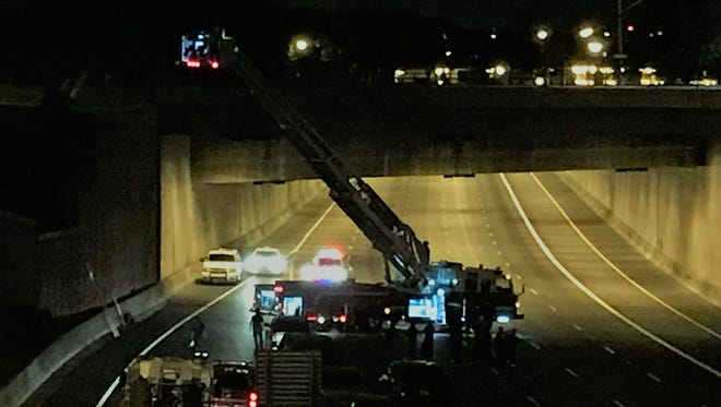 A Phoenix Fire Department ladder truck reaches above the Deck Park Tunnel on Interstate 10 on June 30, 2017. Portions of westbound I-10 were closed because a person was on the Third Avenue overpass.
