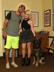 Josh Davis, singer-songwriter Raelynn and their dog Jazz take photos backstage at the Country Music Hall of Fame and Museum during the 2016 CMA Music Festival. Raelynn said Jazz serves as a diabetic alert dog.