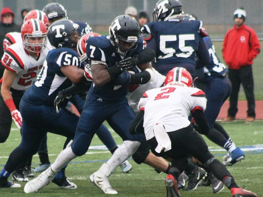 Thurston's Laymon Giddings-Whatley scored four touchdowns in Saturday's victory over Dearborn Divine Child.