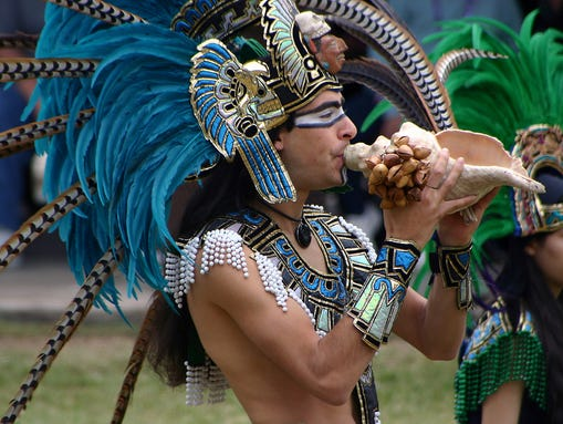 Dancers such as this one, outfitted in an Ehecatl/Aztec