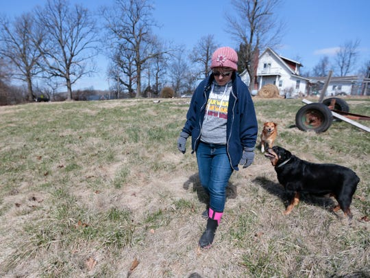 Dolores Halbin walks around the area where her pet