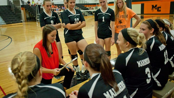 Marine City coach Kelly Thomas talks with players on the sidelines during a volleyball match August 26, 2014 at Marine City High School.