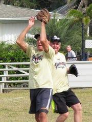Ralph Leiterding of alty Dog grabs a short fly ball
