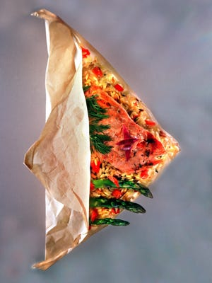 Salmon cooked in parchment paper with asparagus and rice is a good option for pregnant women as both salmon and asparagus contain nutrients needed during pregnancy.