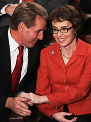 Then-Rep. Jeff Flake talks to Rep. Gabrielle Giffords