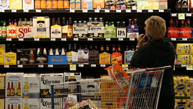 Utah lawmakers moved ahead this week with a bill that would raise alcohol limits for beer sold in stores to 4 percent starting in November, a level that's still lower than almost all other states but would allow beers like Bud Light and Corona to be sold.